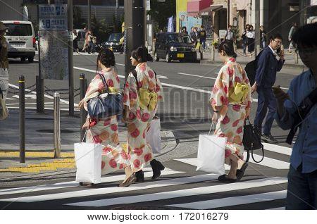 Japanese Women Wear Traditional Japanese Clothing (kimono And Yukatas) Walking Crosswalk Traffic Roa