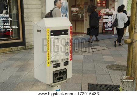 Vending Machine Meter Of Car Parking Beside Traffic Road For People Use At Shinjuku