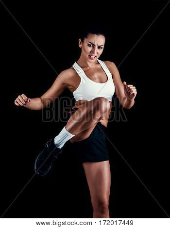 Angry Fitness Girl Ready For Fight On Black Background.