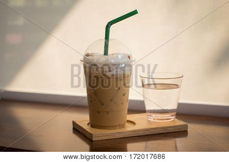 Iced Capuchino coffee on the wood table