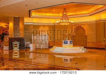 Abu Dhabi, United Arab Emirates - April 21, 2013: one of areas or lobby of monumental main entrance in luxury hotel and landmark Emirates Palace. Decorations inside with gold, marble and Swarovski.