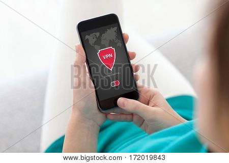 woman holding phone with app vpn creation Internet protocols for protection private network