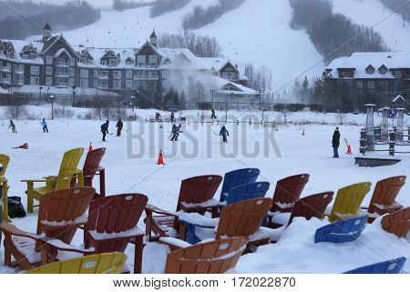 Winter activity under snow blizzard, winter activities and colorful chairs