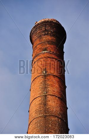 Close up of a tall industrial chimney