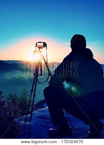 Amateur Photographer Takes Photos With Camera On Peak