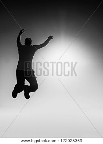 Flying Man. Young Man Falling.  Silhouette Of Poise Man