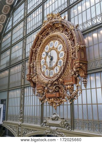 PARIS, FRANCE - 25 AUGUST, 2013 - The Gold Clock located in the