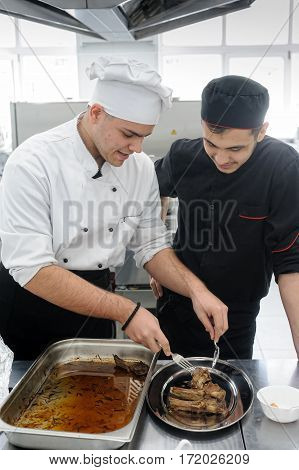 Tyumen Russia - March 23. 2016: Open championship of professional skill among youth. World skills Russia Tyumen - 2016. Young cook prepares food in competition of masters of cook business