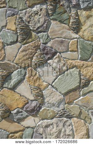 Interesting stone wall decor element with masonry