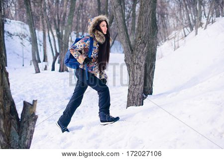 Conquest Mountain Climbing, woman walking forest in winter