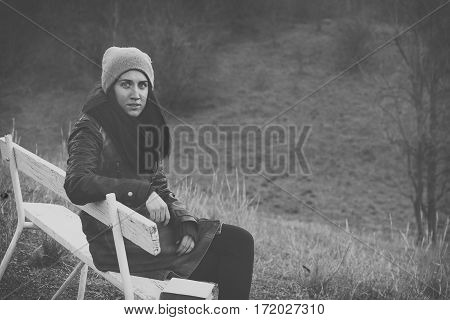 Sad depressed woman concept at autumn outdoors
