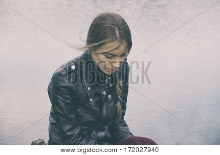 Sad depressed woman portrait concept at summer / spring
