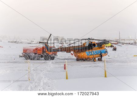 New Urengoy, YaNAO, North of Russia. Helicopter UTair and Konvers avia  in the local airport  on the service. January 06, 2016