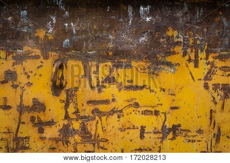 Rusty Metal Scratches Yellow Paint Brown Construction Dumpster Background Texture Closeup