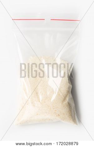 Plastic Transparent Zipper Bag With Half Dry Raw Wheat Semolina Isolated On White, Vacuum Package Mo