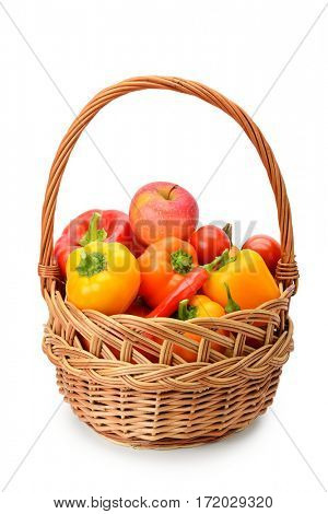 Set of fruits and vegetables in a basket isolated on white background.