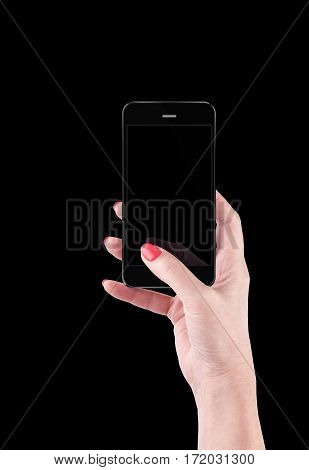 Female Hand holding and Touching a Smartphone isolated on black background.