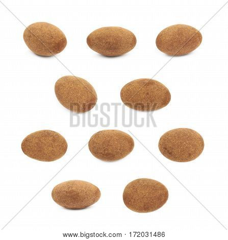 Chocolate coated almond nut isolated over the white background, set of ten different foreshortenings
