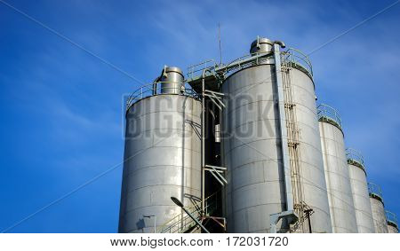 silos in petrochemical plant with blue sky background