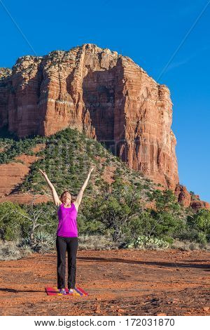 a woman practicing yoga in the red rock landscape of Sedona Arizona