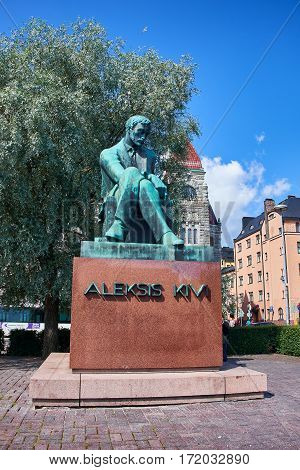 HELSINKI, FINLAND - JULY 17, 2015: Sculpture of Aleksis Kivi on Rautatientori Square in Helsinki. Kivi was among the very earliest authors of prose and lyrics in Finnish language