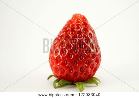 Strawberry have white background.The image vertically see fruit skin closeup.