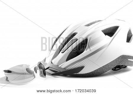 Helmet and glasses on a white background