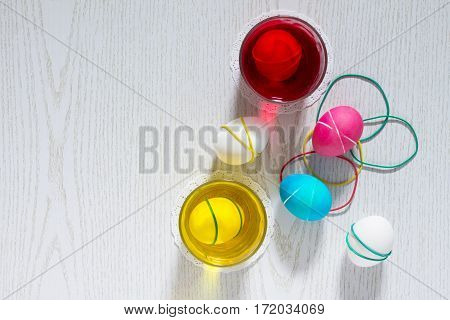 Dyeing Easter Eggs With Different Colors Of Dye And Elastic Bands - Preparation Of Easter Eggs.