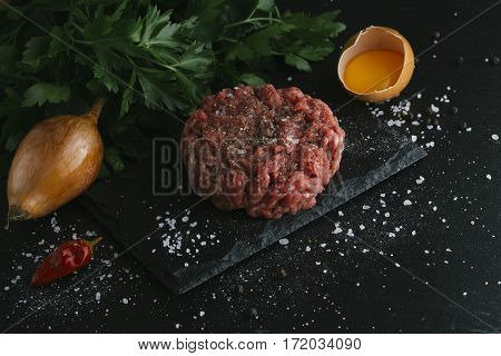Tartare Steak. Beef Raw Chopped Meat With Spices, Herbs And Egg Yolk. Fresh, Spicy, Delicious, Gourm