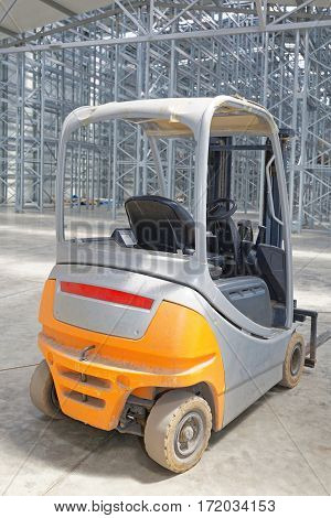 Forklift Truck in Empty New Distribution Warehouse