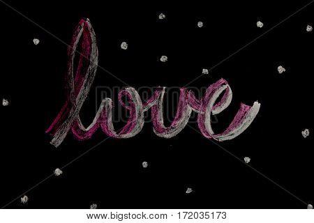 A chalk love word by on blackboard.