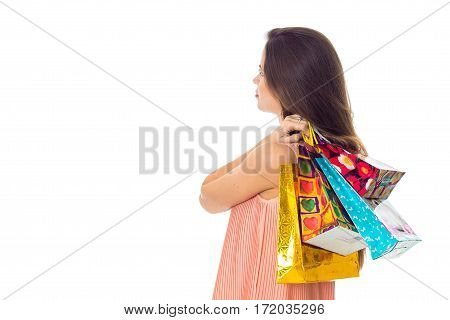 a young girl is worth turning sideways and keeps the color on the shoulder bags isolated on white