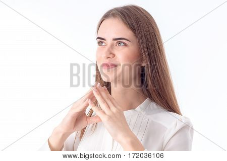 a young girl looks up and keeps two hands near individuals is isolated on a white