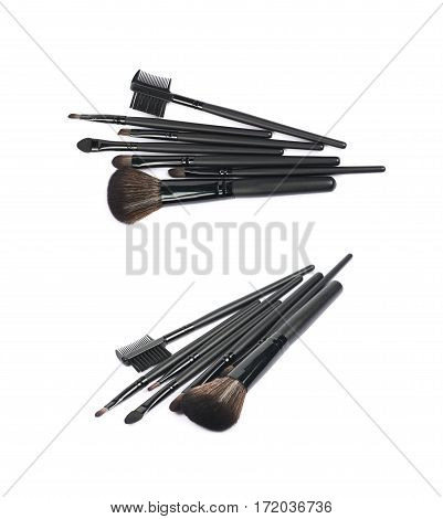 Pile of multiple black makeup tools and brushed isolated over the white background set of two different foreshortenings