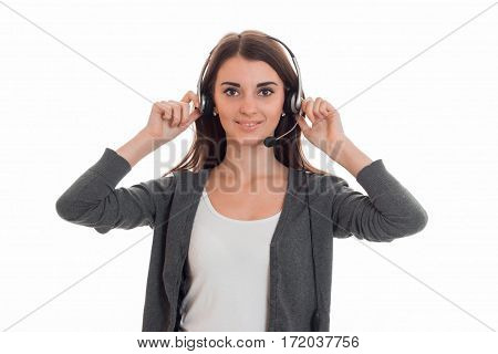 Cutie young business woman working in call center with headphones and microphone looking at the camera and smiling isolated on white