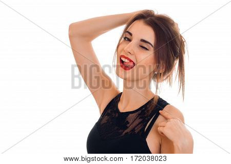 sexual young brunette woman with red lips seduce with her tonque and winking isolated on white