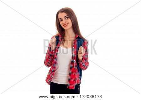 pretty stylish smart student girl with backpack on her shoulders posing and smiling on camera isolated on white