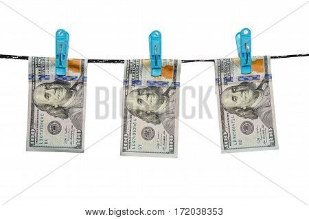 one hundred us dollars are drying on cord isolated on white background