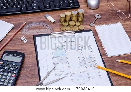 architectural drawings of the modern house with computer keyboard calculator notepad pen coin and pencil