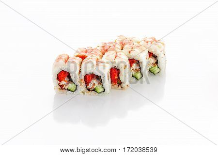 Roll, shrimp, eel, cucumber, tobiko caviar on a white background