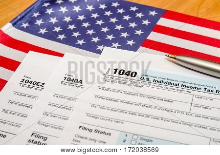 1040 Tax Form With Pen And American Flag