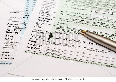 blank tax form with pen close up