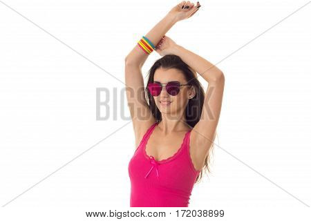 cutie young brunette woman in pink mirror sunglasses and shirt posing and smiling on camera isolated on white