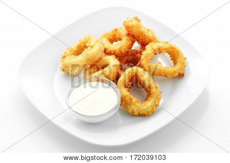 squid rings in batter, sauce, on a white background