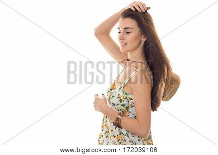 sensual portrait of young beautiful woman in sarafan with floral pattern and straw hat posing isolated on white