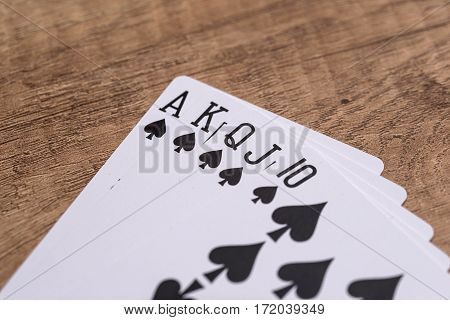 Set of Spade suit play cards on wooden desk