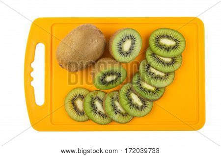Pieces Of Kiwi On Plastic Chopping Board On White