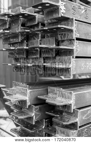 Closeup stack of steel bar heap with lug. Steel construction. Black and white. BW.
