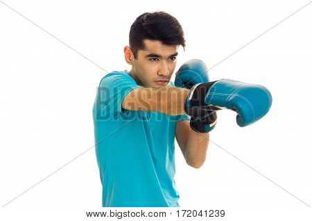portrait of strong brunette sports man practicing box in blue gloves isolated on white