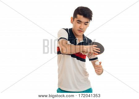 portrait of serious sportsman practicing a ping-pong and concentrated on a game isolated on white